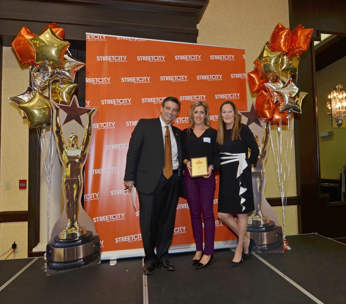 Receiving my award from the owners of StreetCity Costa and Mary at our awards banquet! image